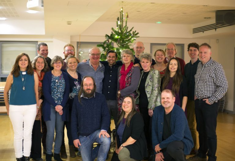 Group photo of graduating students and new lay pioneers in front of the Christmas tree