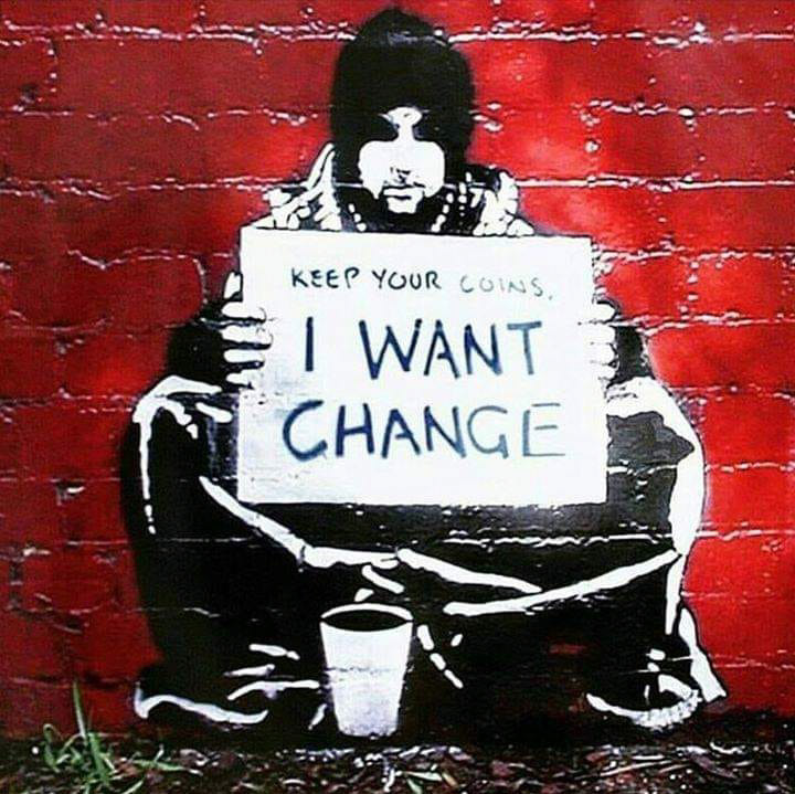 Mural of homeless person, with sign reading Keep your coins. I want change.
