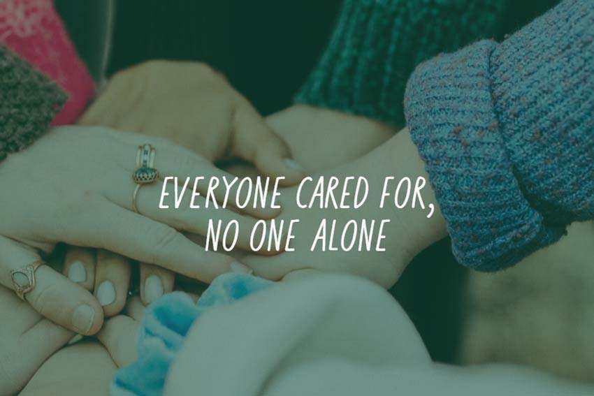"Hands joined in the centre of a circle with text ""everyone cared for, no one alone"""