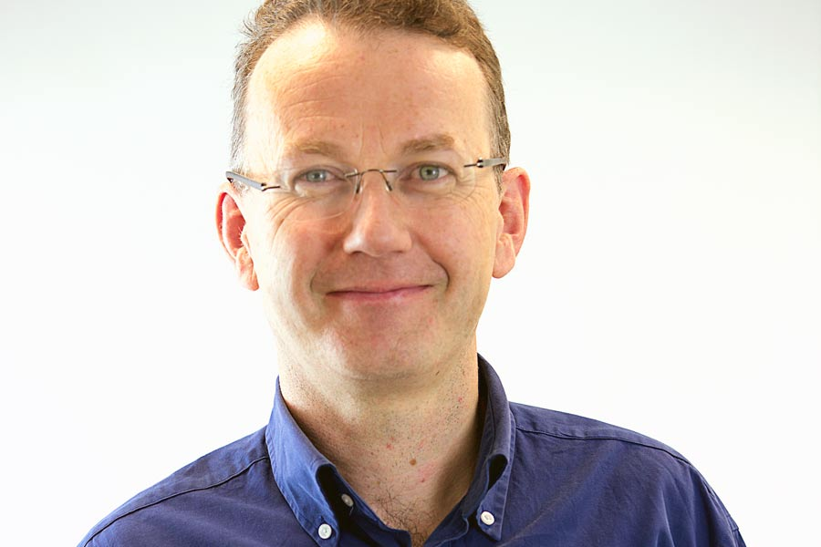 Smiling man in specs