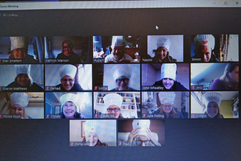 Zoom screenshot of participants in chef's hats