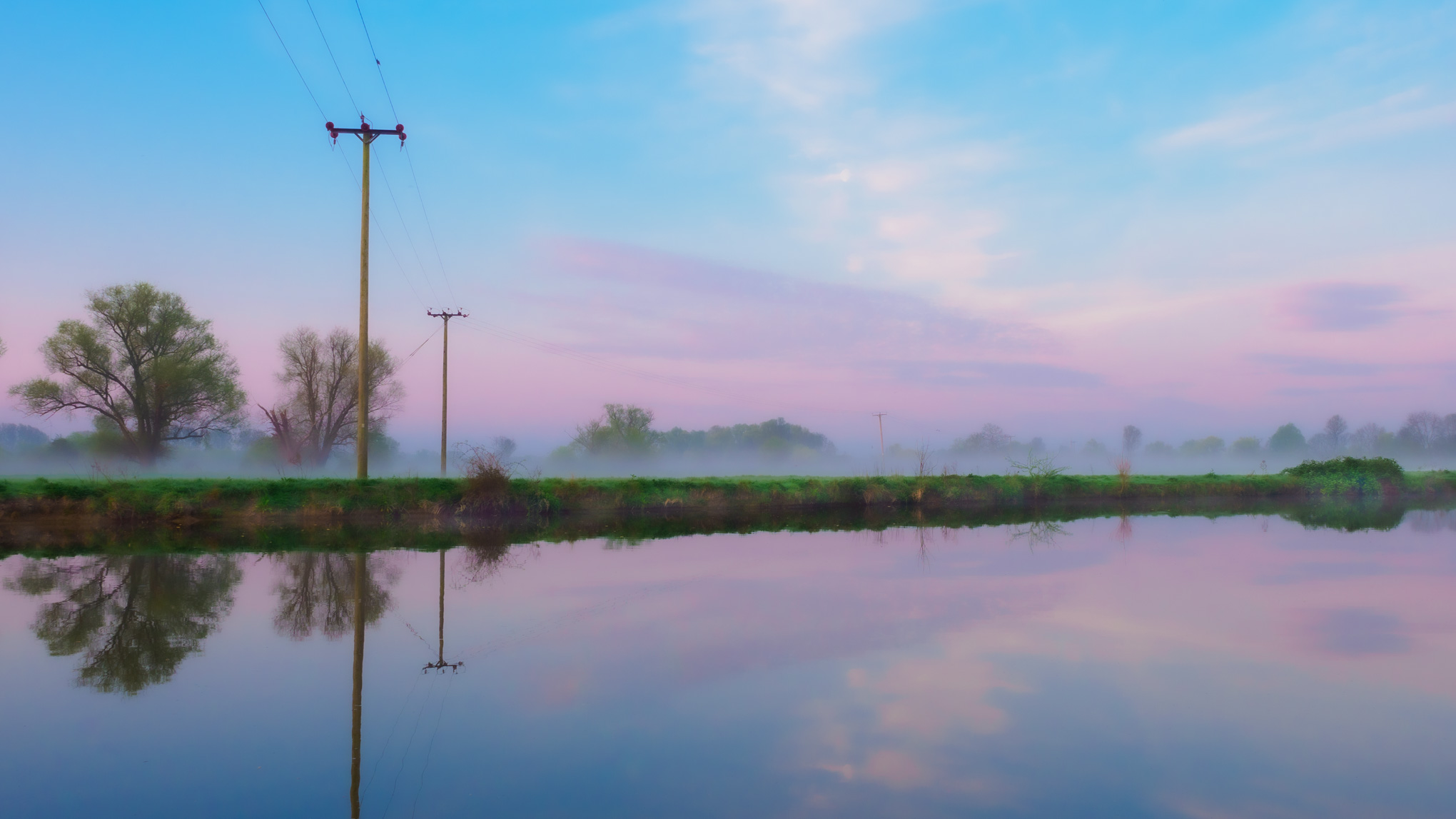 Mist and purple cloud reflected on river