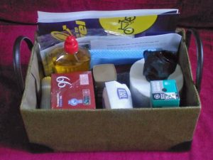 a welcome basket including toilet roll, washing up liquid, tea, coffee, sugar