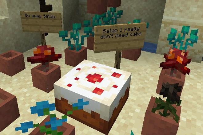 "Minecraft screenshot: large cake with signs saying ""Go away Satan"" and ""Satan I really don;t need cake"""
