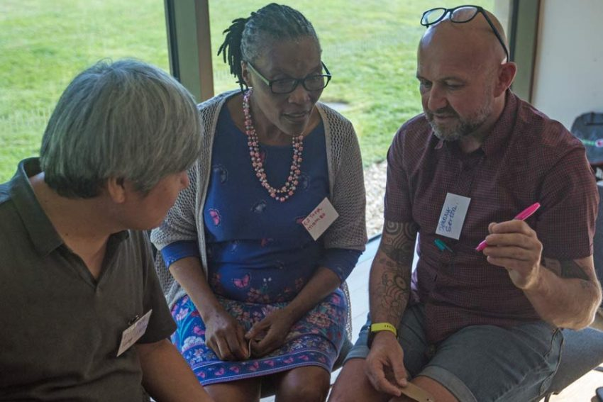 Ambrose from Korea, Esther from Kenya and Johnny from London sharing thoughts at the Hui